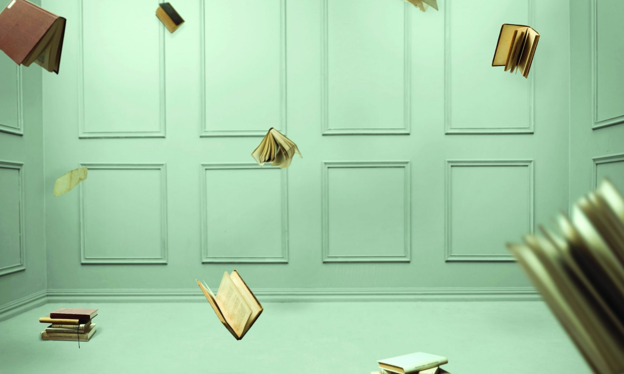 Here are multiple falling books in a closed pale green room. Business Impact article on the place of culture in offering holistic experiences.
