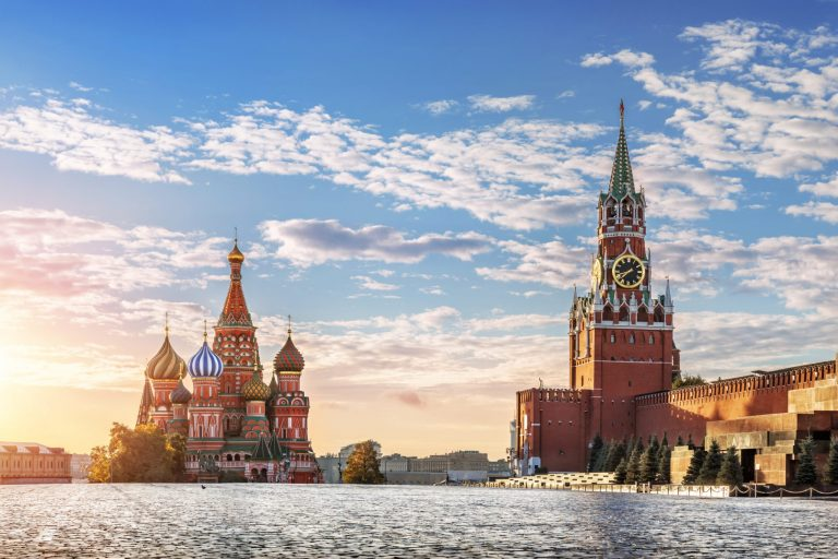 A landscape view of Moscow, Russia, with iconic buildings featuring St Basil's Cathedral and the Kremlin.