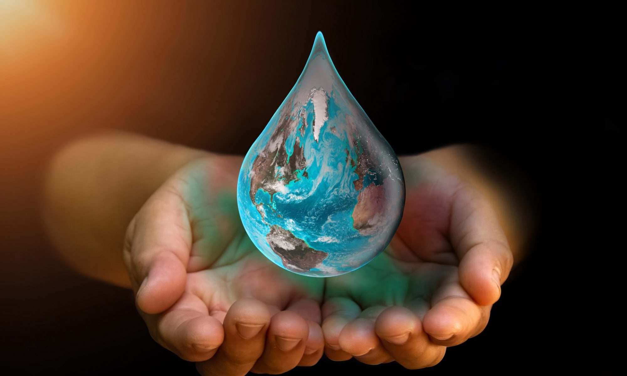 Hands cupping the earth that is shaped like a giant water droplet. Adding drops to the ocean of change.