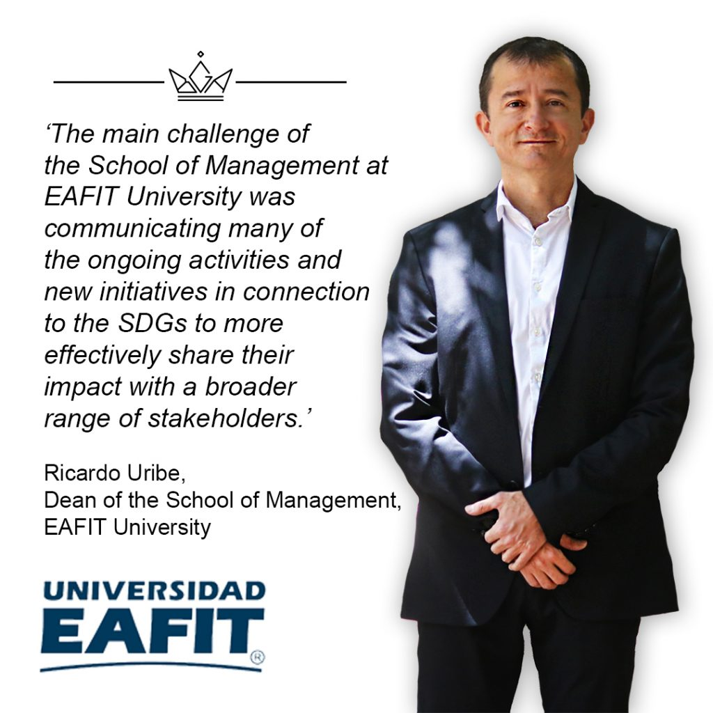 A banner with the Dean of EAFIT University standing with hands crossed over supported by the wrists. There is also text which quotes the main Business School challenge and a logo of the Business School.