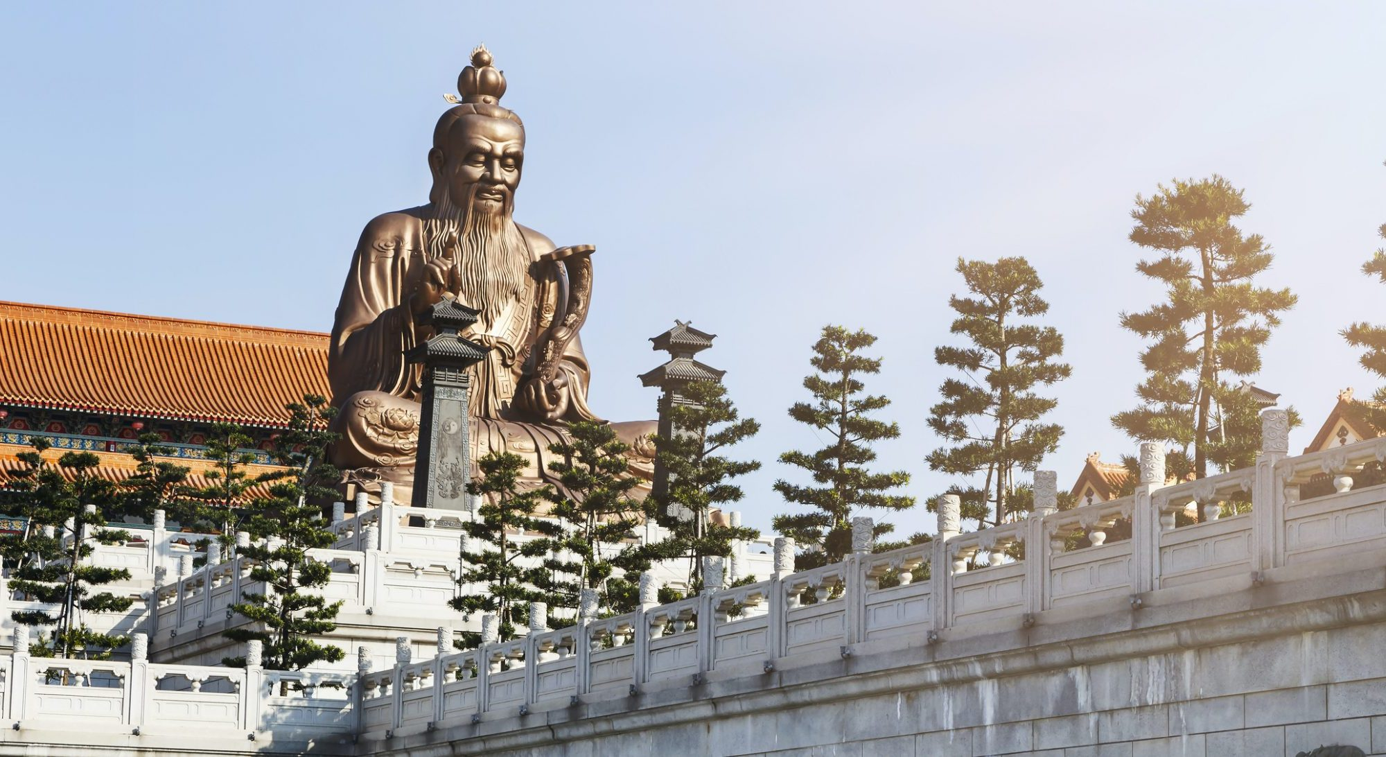 A Chinese statue on top of a temple inspired building in Laozi, China symbolic philosophy of life and leadership