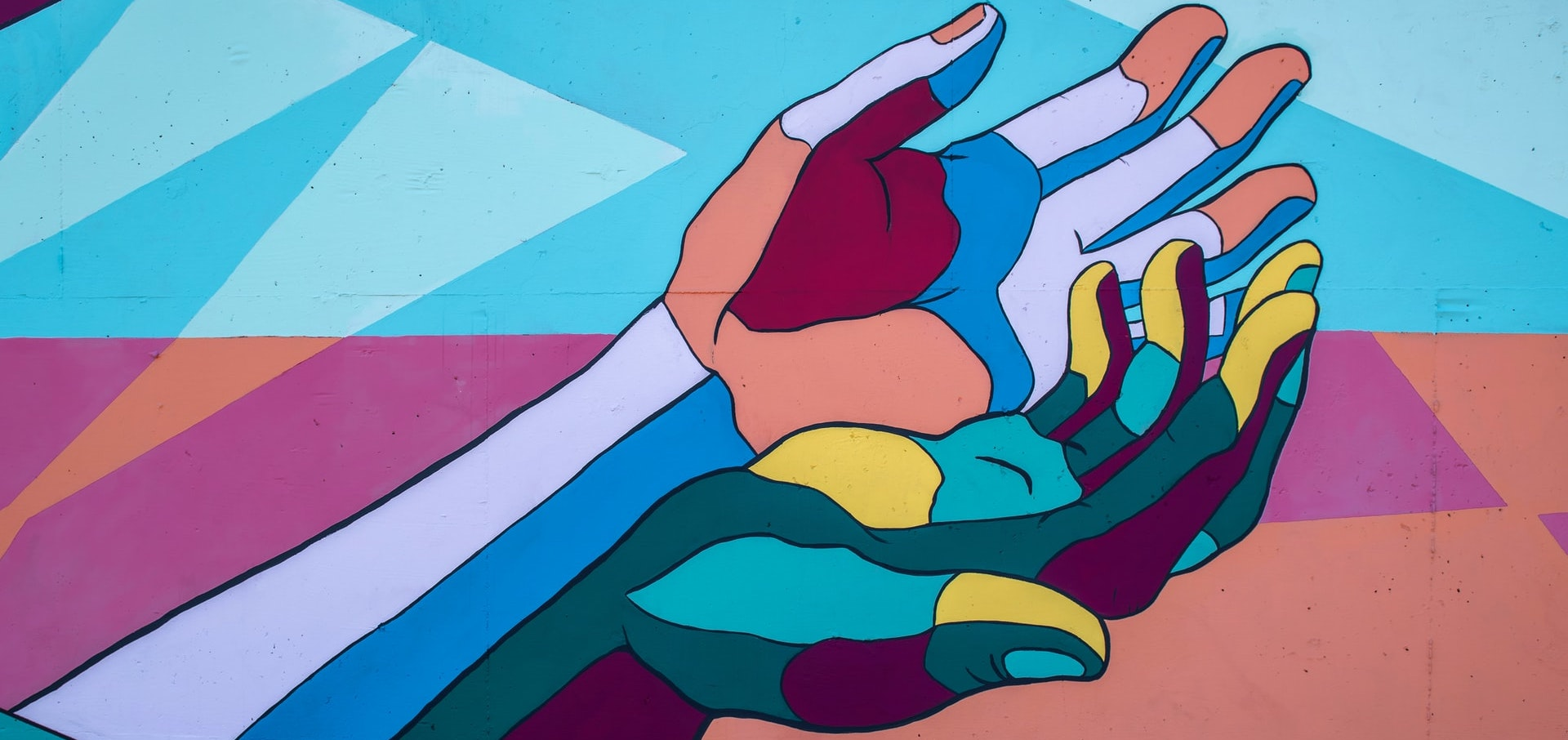 Abstract illustration of two duo-tone coloured hands touching the side of the palms symbolising diversity and inclusion.