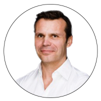 The Head of Global Talent Acquisition and Engagement, TUI Group and Judge of AMBA & BGA Excellence Awards smiling and dressed in a bright white shirt unbuttoned collar.
